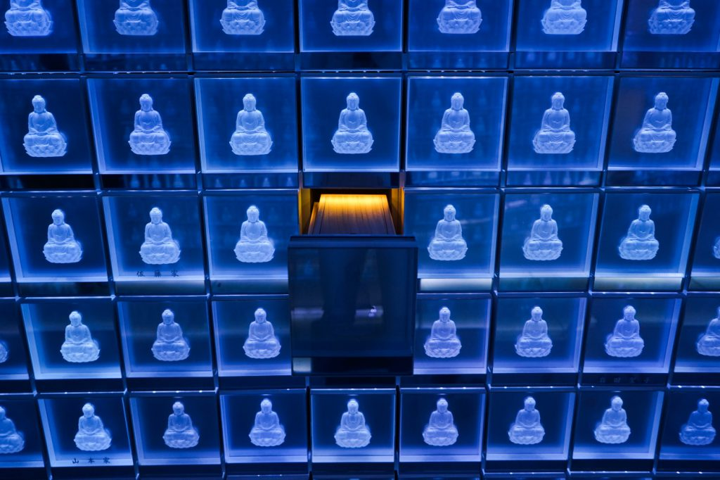 A wooden container that has bones and ashes in a drawer at the Banshoji temple in Nagoya city, there are sinerarias in the main building. On the 3rd floor, there is a crystal place called Suishoden. In this hall, blue LED (light-emitting diodes) illuminate 2,000 small glass containers stacked along the hall's walls, each container is decorated with an image of the Buddha. A visitor put an electronic identity card at the entrance and the appropriate urn lights up in gold. Regardless of the religious sect memorial services are held.